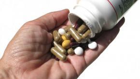 pills.bottle.hand__0.jpg